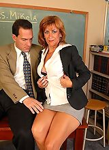 Two mature lecherous teachers are jumping bones in classroom on table