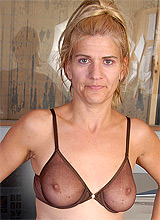 amateur granny wife in transparent bras undresses in fron of camera