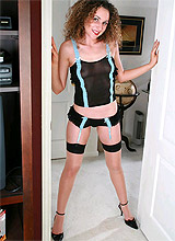 Curly-haired milf entertains in stockings without shame in hall