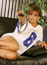 Spanish mature wife watching football match on tv