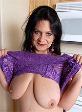 brunette mature babe with huge tits
